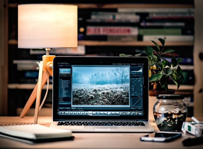 A MacBook Pro with a photo editing software open
