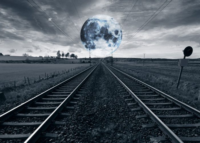 Train tracks and a full moon