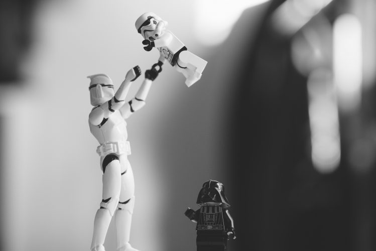 A Star Wars family with stormtroopers and Darth Vader
