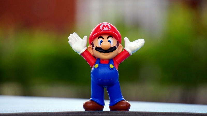 Super Mario toy celebrating